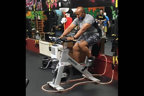 CSM Jerome Wren takes a spin on his exercise bike during a routine workout. (CSM Jerome Wren)