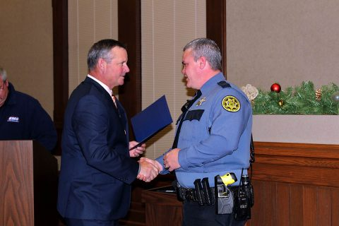 Montgomery County Sheriff's Office Deputy Randy Paddock receives the Lifesaver Award from Mayor Jim Durrett.