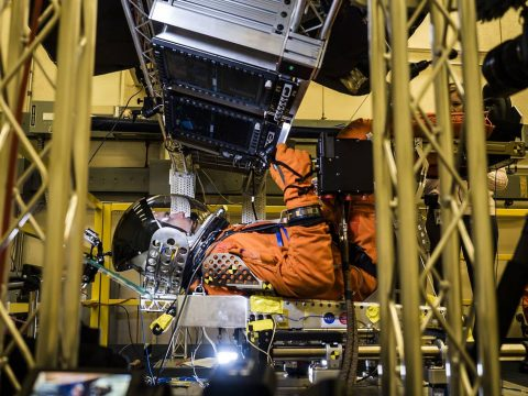 In a lab at NASA's Johnson Space Center in Houston, engineers simulated conditions that astronauts in space suits would experience when the Orion spacecraft is vibrating during launch atop the agency's powerful Space Launch System rocket on its way to deep space destinations. (NASA/Rad Sinyak)