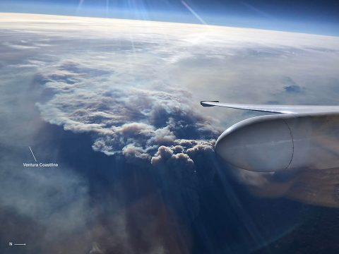 The Ventura coastline is barely visible under a plume of smoke as NASA's ER-2 high-altitude aircraft carrying JPL's AVIRIS spectrometer instrument surveys the Southern California wildfires on Dec. 7, 2017. (NASA/Tim Williams)