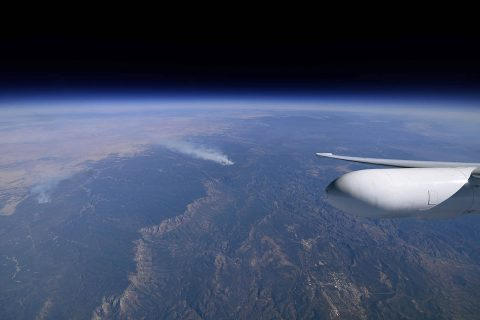 The view from NASA's ER-2 flying at approximately 65,000 feet (19,812 meters) near a controlled fire burning near Flagstaff, Arizona, during the Aerosol Characterization from Polarimeter and Lidar (ACEPOL) airborne campaign on Nov. 7, 2017. (NASA/Stu Broce)