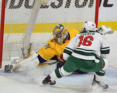 Nashville Predators goalie Juuse Saros (74) makes a save on a shot by Minnesota Wild left wing Jason Zucker (16) during the first period at Bridgestone Arena. (Christopher Hanewinckel-USA TODAY Sports)