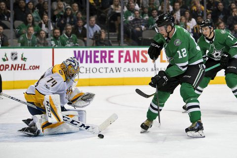 Nashville Predators goalie Juuse Saros (74) stops a shot by Dallas Stars center Radek Faksa (12) during the second period at the American Airlines Center. (Jerome Miron-USA TODAY Sports)