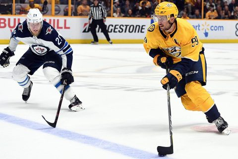 Nashville Predators defenseman Roman Josi (59) skates the puck into the offensive zone as he is defended by Winnipeg Jets right wing Patrik Laine (29) during the third period at Bridgestone Arena. (Christopher Hanewinckel-USA TODAY Sports)