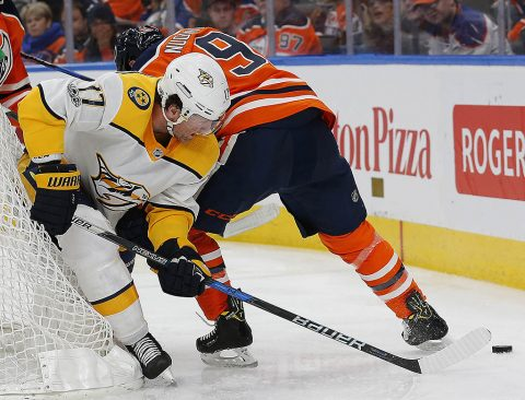 Nashville Predators forward Scott Hartnell (17) and Edmonton Oilers forward Ryan Nugent-Hopkins (93) battle for a loose puck during the third period at Rogers Place. (Perry Nelson-USA TODAY Sports)