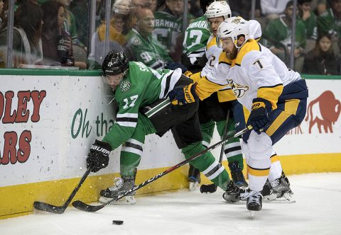 Dallas Stars center Devin Shore (17) and Nashville Predators defenseman Yannick Weber (7) fight for the puck during the second period at the American Airlines Center. (Jerome Miron-USA TODAY Sports)