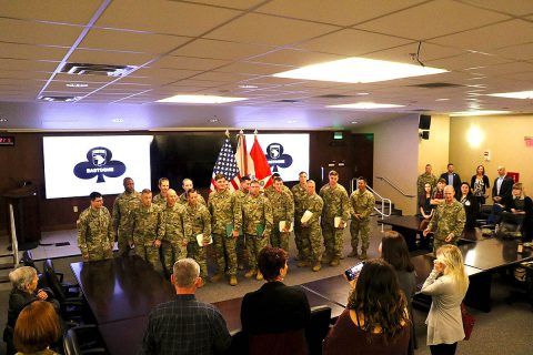 Six Soldiers from 1st Brigade Combat Team, 101st Airborne Division (Air Assault), who received the Soldier's Medal, stand with their leadership at the conclusion of the ceremony held at the 101st ABN DIV (AASLT) headquarters, Nov. 28. (Lt. Col. Martin L. O'Donnell, 101st Airborne Division (Air Assault) Public Affairs)