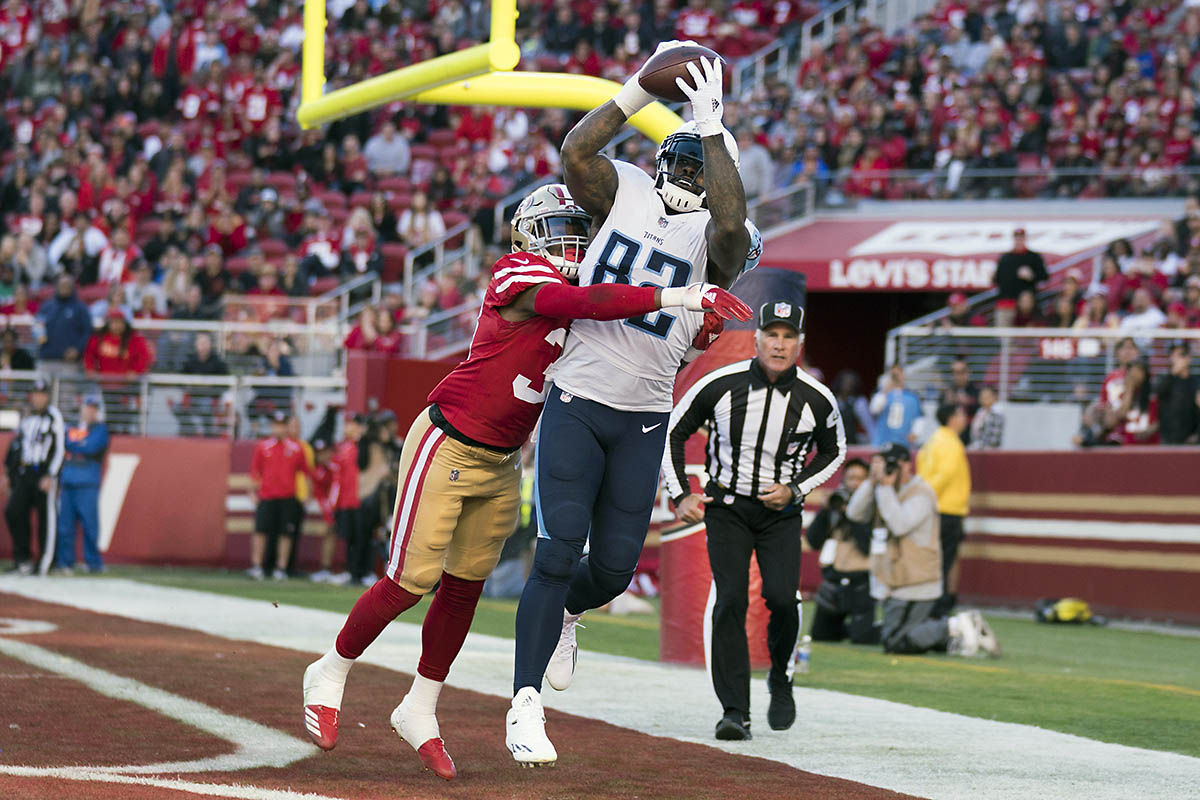 Tennessee Titans tight end Delanie Walker (82) catches a touchdown pass against San Francisco 49ers defensive back Adrian Colbert (38) during the second quarter at Levi's Stadium. (Kyle Terada-USA TODAY Sports)