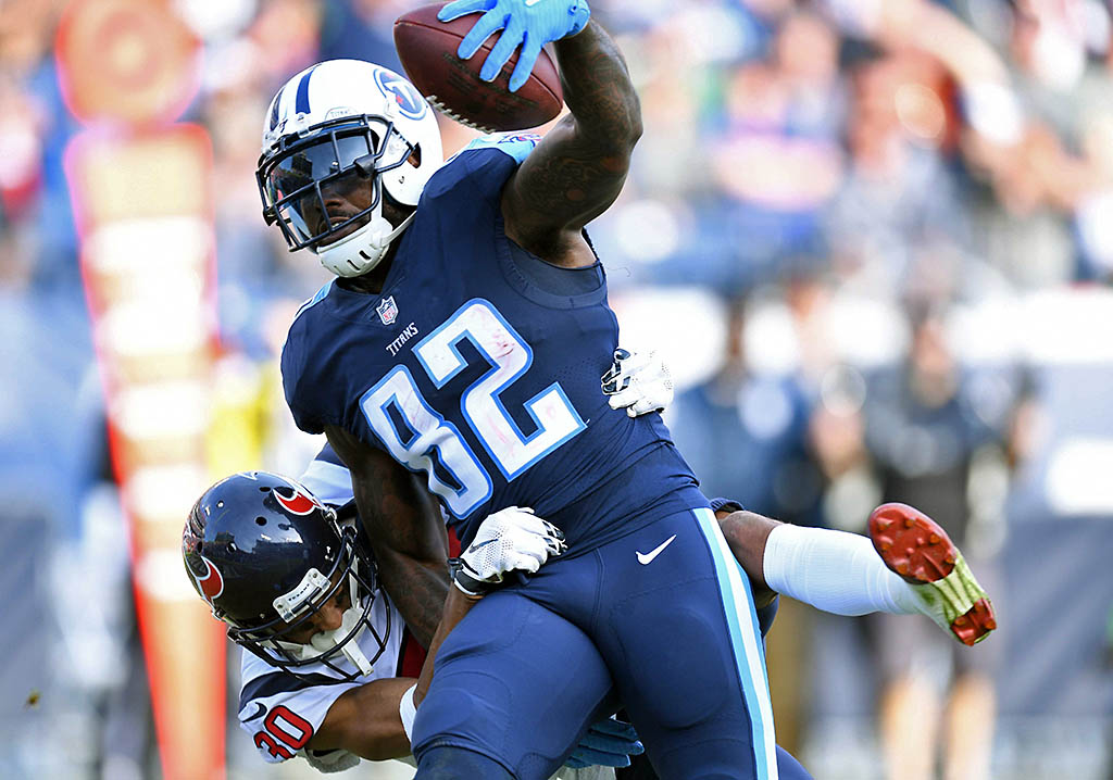 Tennessee Titans tight end Delanie Walker (82) carries Houston Texans cornerback Kevin Johnson (30) into the end zone for a touchdown during the second half at Nissan Stadium. (Christopher Hanewinckel-USA TODAY Sports)