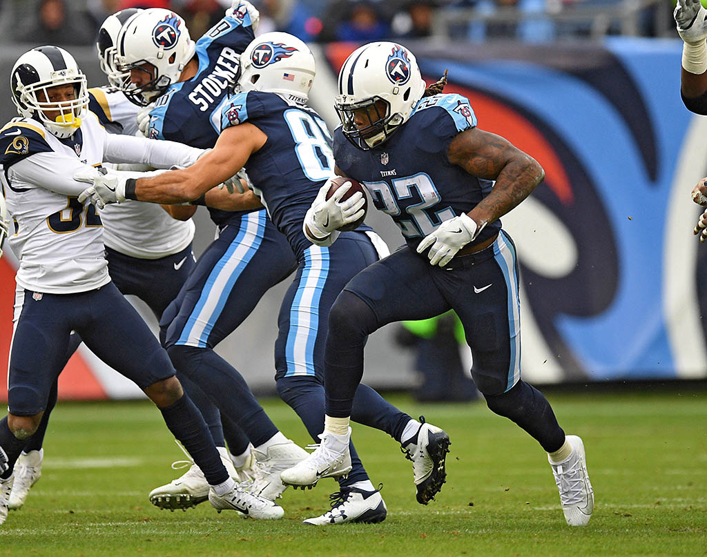 Tennessee Titans running back Derrick Henry (22) runs for a short gain during the first half against the Los Angeles Rams at Nissan Stadium. (Christopher Hanewinckel-USA TODAY Sports)