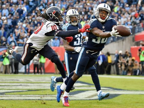 Tennessee Titans cornerback LeShaun Sims (36) intercepts a pass intended for Texans wide receiver DeAndre Hopkins (10) during the second half at Nissan Stadium. (Andrew Nelles/The Tennessean via USA TODAY Sports)