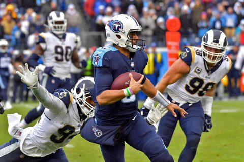 Tennessee Titans quarterback Marcus Mariota (8) rushes against Los Angeles Rams outside linebacker Robert Quinn (94) during the second half at Nissan Stadium. (Jim Brown-USA TODAY Sports)