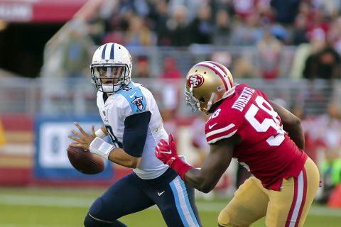 Tennessee Titans quarterback Marcus Mariota (8) scrambles with the ball against San Francisco 49ers defensive end Elvis Dumervil (58) during the third quarter at Levi's Stadium. (Sergio Estrada-USA TODAY Sports)