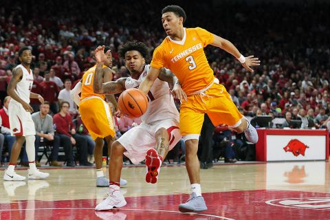 Arkansas Razorbacks guard Anton Beard (31) and Tennessee Volunteers guard James Daniel III (3) reach for a loose ball at Bud Walton Arena. Arkansas won 95-93. (Nelson Chenault-USA TODAY Sports)