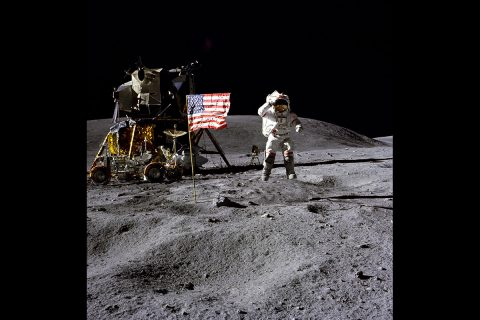 John Young on the Moon, with the Lunar Module and Lunar Rover in the background. (NASA)