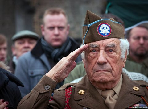 "WWII Battle of the Bulge veteran Vincent Speranza salutes the U.S. flag at the 17th Airborne Division Memorial in Bertogne, Belgium, during a ceremony to commemorate the 71st anniversary of the Battle of the Bulge, Dec. 13, 2015. The text on the Monument reads as follows: ""In proud remembrance of the men of the 17th Airborne Division who fought in this area during the Battle of the Bulge in January 1945. They fought that we might be free."" (U.S. Army photo by Staff Sgt. Bernardo Fuller/Released)"