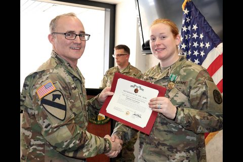 Blanchfield Army Community Hospital Commander, Col. Anthony L. McQueen, presents Sgt. Olivia Barker the Army Commendation Medal during an award ceremony Jan. 19, for her selection as the hospital's NCO of the Year. Barker and fellow candidates competed in nine events including marksmanship, a physical fitness test, written exam with essay, selection board appearance, land navigation and battle drills. (U.S. Army, Maria Yager)