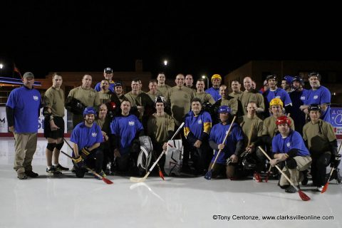 Fort Campbell and Montgomery County competed in Clarksville's first ever broomball match at the Downtown Commons outdoor ice skating rink.