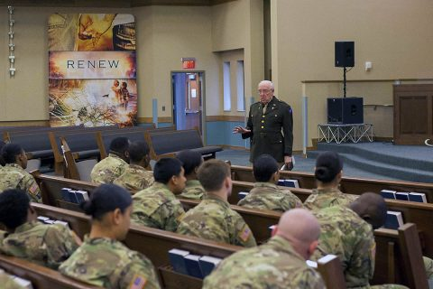 Dr. Dick Stennebaken, retired Army Chaplain (Col.), weaves a tale about being a chaplain during the Nuremburg trails, to unit ministry teams in attendance at Liberty Chapel, Fort Campbell, Kentucky, 19 Jan. The skit was intended to feel very real, with the majority of attendees not knowing it's just acting. (Sgt. Samantha Stoffregen, U.S. Army)
