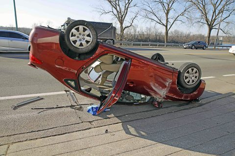 2008 Hyundai hits a light pole on Riverside Drive causing it to flip over and land on it's roof. (Jim Knoll, CPD)