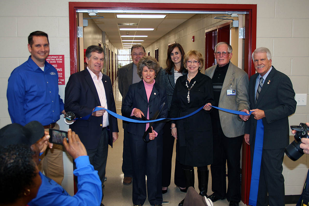 Clarksville Mayor Kim McMillan cuts a ribbon Wednesday to dedicate the new 17,000 square foot addition to the Ajax Turner Senior Citizens.