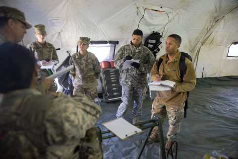 A team of Soldiers with the 101st Airborne Division (Air Assault), 86th Combat Aviation Support Hospital and Blanchfield Army Community Hospital conduct an interview with a 3rd Brigade Combat Team medic as part of a field exercise portion during a preventative medicine course October 26, 2017. Three teams were given varying scenarios in which they had to identify the health issue, conduct interviews and perform soil, water, or air tests. (Sgt. Samantha Stoffregen, 101st Airborne Division (Air Assault) public affairs)