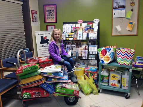 This young lady collected pet food donations for the Humane Society in lieu of gifts for her birthday, which is a great way to support the pet food bank. The pet food bank serves low income families, Humane Society foster families, and local rescue organizations when overstock permits. (Humane Society of Clarksville-Montgomery County)