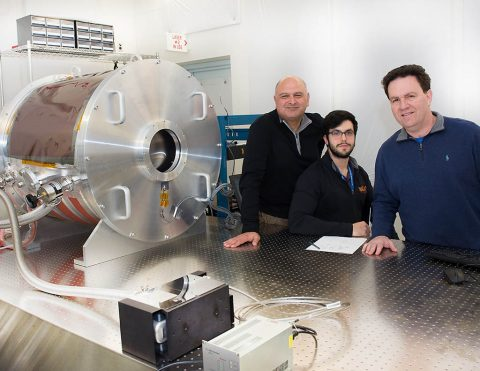 Goddard optics experts Babak Saif (left) and Lee Feinberg (right), with help from engineer Eli Griff-McMahon an employee of Genesis, have created an Ultra-Stable Thermal Vacuum system that they will use to make picometer-level measurements. (NASA/W. Hrybyk)