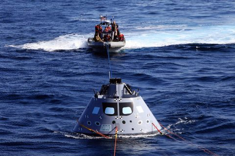 NASA Recovery Team rehearses picking up the Orion capsule in the Pacific Ocean. (NASA)