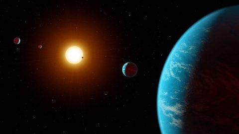 This artist concept shows K2-138, the first multi-planet system discovered by citizen scientists. The central star is slightly smaller and cooler than our Sun. The five known planets are all between the size of Earth and Neptune. Planet b may potentially be rocky, but planets c, d, e, and f likely contain large amounts of ice and gas. All five planets have orbital periods shorter than 13 days and are all incredibly hot, ranging from 800 to 1,800 degrees Fahrenheit. Image credit: NASA/JPL-Caltech