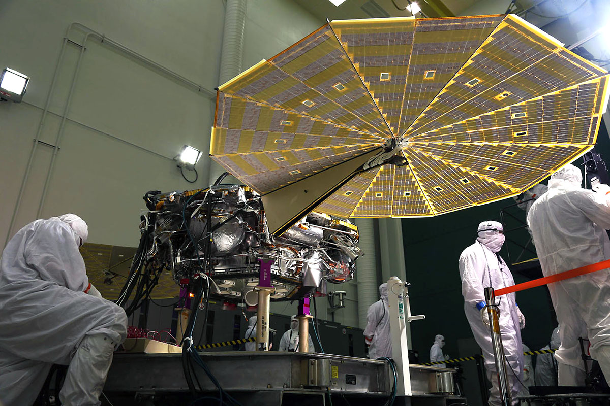 The solar arrays on NASA's InSight Mars lander were deployed as part of testing conducted Jan. 23, 2018, at Lockheed Martin Space in Littleton, Colorado. Engineers and technicians evaluated the solar arrays and performed an illumination test to confirm that the solar cells were collecting power. The launch window for InSight opens May 5, 2018. (Lockheed Martin Space)
