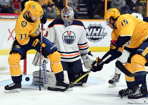 Nashville Predators right wing Craig Smith (15) scores a goal past Edmonton Oilers goalie Cam Talbot (33) as left wing Viktor Arvidsson (33) assists during the first period at Bridgestone Arena. (Christopher Hanewinckel-USA TODAY Sports)