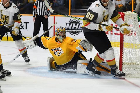 Nashville Predators goalie Juuse Saros (74) makes a save during the second period against the Vegas Golden Knights at Bridgestone Arena. (Christopher Hanewinckel-USA TODAY Sports)