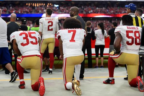 San Francisco 49ers free safety Eric Reid (35) and San Francisco 49ers quarterback Colin Kaepernick (7) and San Francisco 49ers outside linebacker Eli Harold (58) kneel during the national anthem during the first half against the Arizona Cardinals at University of Phoenix Stadium. (Joe Camporeale-USA TODAY Sports)