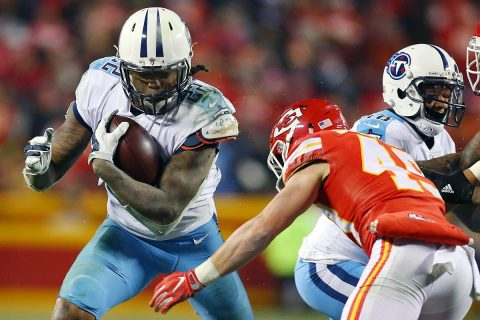 Tennessee Titans running back Derrick Henry (22) runs the ball against Kansas City Chiefs strong safety Daniel Sorensen (49) during the third quarter in the AFC Wild Card playoff football game at Arrowhead Stadium. (Jay Biggerstaff-USA TODAY Sports)