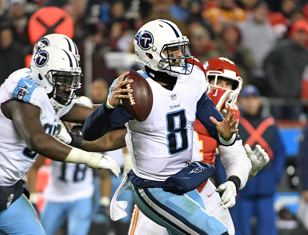 Tennessee Titans quarterback Marcus Mariota (8) throws a pass against the Kansas City Chiefs during the fourth quarter in the AFC Wild Card playoff football game at Arrowhead Stadium. (Denny Medley-USA TODAY Sports)