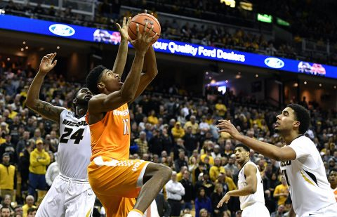 Tennessee Volunteers forward Kyle Alexander (11) shoots as Missouri Tigers forward Kevin Puryear (24) and forward Jontay Porter (11) defend during the second half at Mizzou Arena. (Denny Medley-USA TODAY Sports)