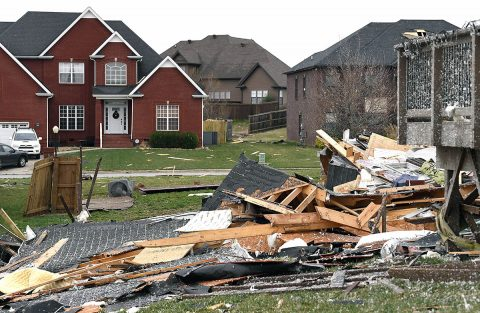 Debris is strewn throughout the neighborhood Sunday morning after a fierce storm hit Saturday night in the Farmington subdivision. (Lacy Atkins/The Tennessean via USA TODAY NETWORK)