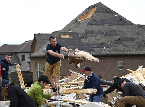 People work to clear debris after a fierce storm hit Saturday night in the Farmington subdivision. (Lacy Atkins/The Tennessean via USA TODAY NETWORK)