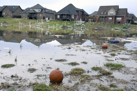 Basketballs rests in water surrounded by debris Sunday morning after a fierce storm hit Saturday night in the Farmington subdivision in Clarksville, TN. (Lacy Atkins/The Tennessean via USA TODAY NETWORK)