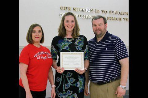 Pisgah Elementary Principal Sallie Oden and School Board member Josh Baggett congratulate Amber Hartzler.