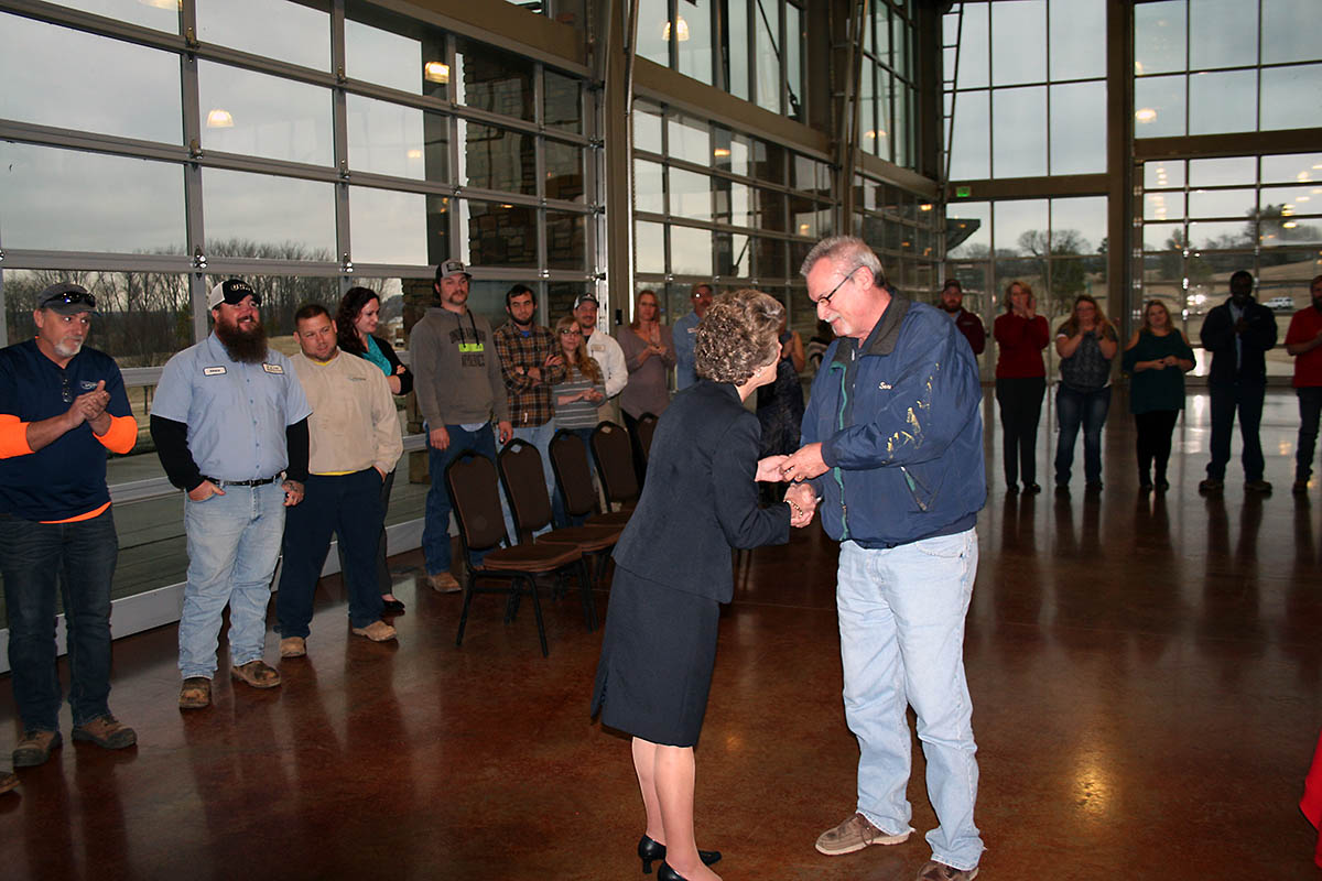 Michael McWhorter, Materials Management Supervisor at Clarksville Gas and Water, accepts a 45-year service pin from Clarksville Mayor Kim McMillan. He was the longest serving of the 285 City employees who received pins from McMillan during her annual employee service awards breakfast on Thursday.