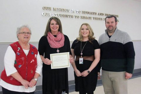 MCES recognized with Point of Pride at School Board meeting. From left, retired MCES principal Nancy Grant, Principal Loralee BeCraft, Assistant Principal Roshae Harrison, School Board member Josh Baggett.