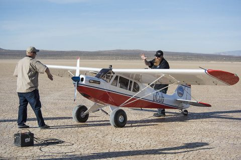 Crew members of the Subscale Research Lab at NASA's Armstrong Flight Research Center in California perform a series of preflight system checks of the MicroCub to ensure the aircraft is ready for its maiden flight. (NASA Photo / Lauren Hughes)
