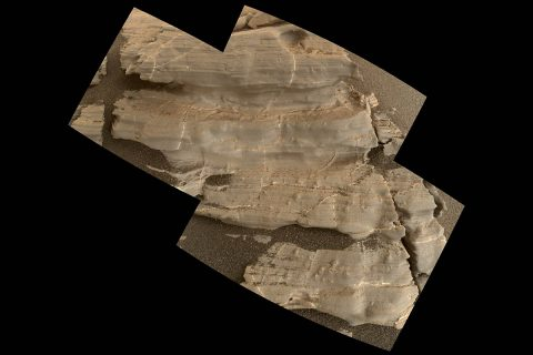 "This exposure of finely laminated bedrock on Mars includes tiny crystal-shaped bumps, plus mineral veins with both bright and dark material. This rock target, called ""Jura,"" was imaged by the MAHLI camera on NASA's Curiosity Mars rover on Jan. 4, 2018, during Sol 1925 of the mission. (NASA/JPL-Caltech/MSSS)"