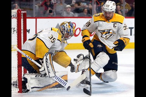 Nashville Predators goaltender Pekka Rinne (35) makes a save against the Montreal Canadiens as Nashville defenseman Roman Josi (59) assists during the second period at Bell Centre. (Jean-Yves Ahern-USA TODAY Sport)