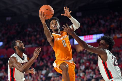 Tennessee Volunteers guard Jordan Bone (0) goes to the basket between Georgia Bulldogs guard William Jackson II (0) and forward Rayshaun Hammonds (20) during the first half at Stegeman Coliseum. (Dale Zanine-USA TODAY Sports)