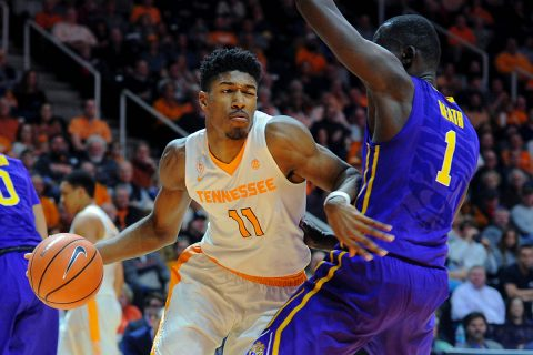 Tennessee Volunteers forward Kyle Alexander (11) moves the ball defended by LSU Tigers forward Duop Reath (1) during the second half at Thompson-Boling Arena. Tennessee won 84-61. (Randy Sartin-USA TODAY Sports)