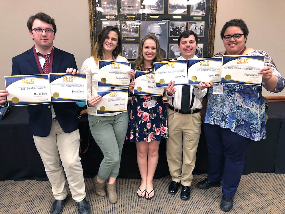 The All State staff show their 10 awards from the the annual Southeast Journalism Conference.