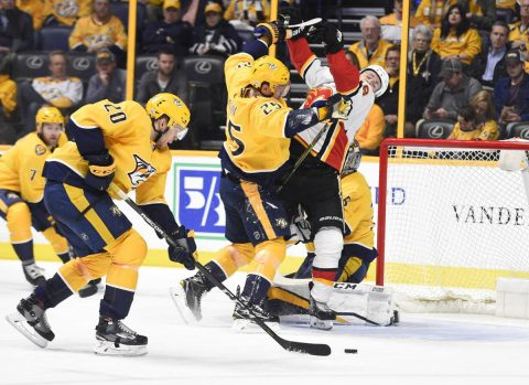Feb 15, 2018; Nashville, TN, USA; Nashville Predators defenseman Alexei Emelin (25) checks Calgary Flames left wing Matthew Tkachuk (19) in front of the Nashville Predators net during the second period at Bridgestone Arena. Mandatory Credit: Steve Roberts-USA TODAY Sports
